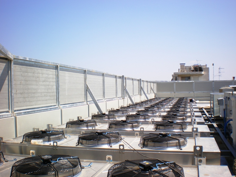 Roof HVAC noise barrier with louvers